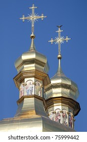 Gilded cupolas with crosses of the the Assumption Cathedral at Kiev Pechersk Lavra Orthodox monastery, Ukraine