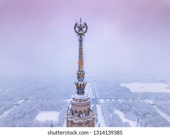 Gilded star on the spire of the famous Moscow skyscraper in winter weather