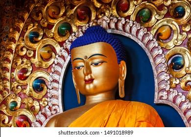 Gilded statue of Sakyamuni Buddha in Tsuglagkhang temple. McLeod Ganj, Himachal Pradesh, India