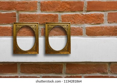 Gilded wooden frames for pictures on old brick stone wall
