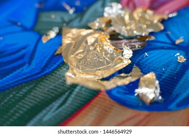 Gilding theme with a leaf of beaten gold and blade