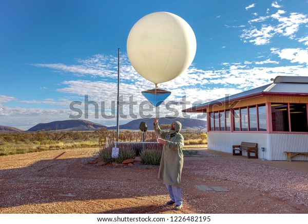 Giles, Western Australia - August 19, 2010:Launching the balloon at Australia's most remote weather station. Giles Weather Station, located in Western Australia near the Northern Territory border,