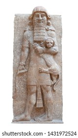 Gilgamesh as Master of Animals, grasping a lion in his left arm and snake in his right hand in an Assyrian palace relief from Dur-Sharrukin
