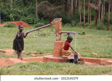 Gilgil, Nakuru County Kenya, November 23 2017, small children collecting water from the school well. Many families do not have access to clean water at home and children carry it for long distances.