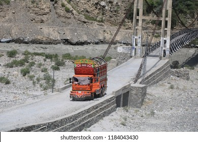 Gilgit, Pakistan - August, 16, 2018: Traditionally decorated truck on mountain road