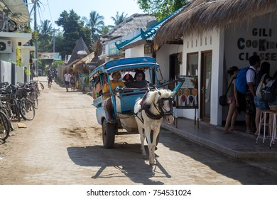 Gili Air, Indonesia - July 12, 2015: Tourists being transported in a traditional horse cart
