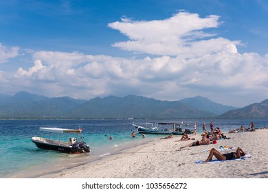 GILI AIR, INDONESIA - SEPTEMBER 27, 2017: People relaxing on the beach during sunny day on Gili Air island.