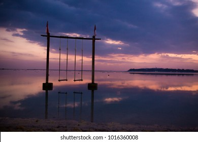 Gili Air sunset scenery with the famous swings
