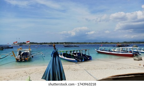Gili Trawangan, Lombok / Indonesia - July 14, 2018: A view from Gili trawangan beach with some boats in the coastline in a suny day