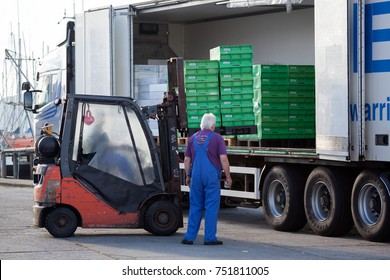 GILLELEJE, ZEALAND, DENMARK - AUGUST 17, 2107: Loading fish palettes into back of lorry