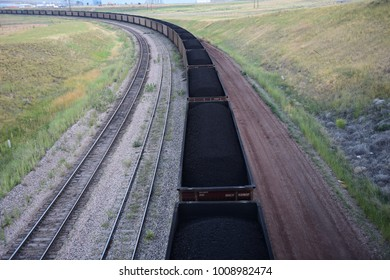 Gillette, Wyoming / USA - July 21 2017: Coal train transporting coal from an open pit mine in the Powder River Basin of Wyoming.