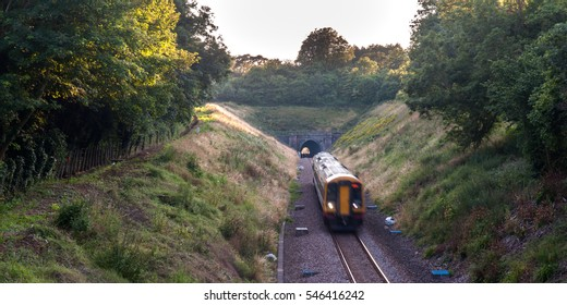 Gillingham, England - July 24, 2012: A South West Trains Class 159 diesel passenger train on the West of England Main Line at Sandley Tunnel in the North Dorset countryside.