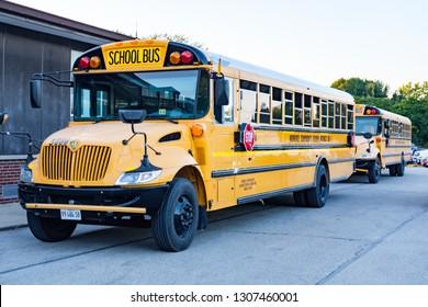 Gilman Illinois. USA. September 2018. School buses from Momence Community School District No1, Illinois.