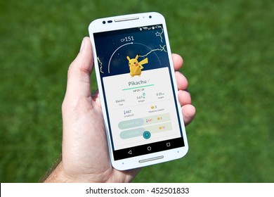 "GILROY, CALIFORNIA - JULY 14, 2016: A person playing the hit smartphone app ""Pokemon GO"" views a captured Pikachu while searching outside for new Pokemon."