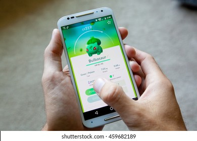 "GILROY, CALIFORNIA - JULY 28, 2016: A person playing the hit smartphone app ""Pokemon GO"" views a captured Bulbasaur before searching for new Pokemon."