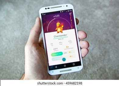 """GILROY, CALIFORNIA - JULY 28, 2016: A person playing the hit smartphone app """"Pokemon GO"""" views a captured Charmander before searching for new Pokemon."""