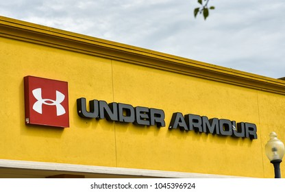 Gilroy, CA/USA - Mar. 12, 2018: Under Armour company name and logo at its branch store at Gilroy Premium Outlets, Gilroy, CA.