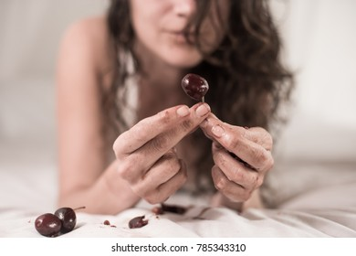 gils hands holding a cherry