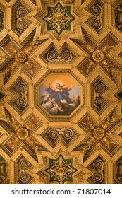 Gilt ceiling with an ikon in Santa Maria Maggiroe Temple in Rome, Italy. Useful fol religious pattern backgrounds.