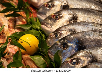 Gilt-head bream and Red mullet for sale et fish market in France. Fish has important nutrients, such as protein, vitamin D, omega-3. Healthy diet concept.