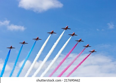 GILZE RIJEN, THE NETHERLANDS - JUNE 21: RAF Red Arrows performing at the Dutch Air Force Open House. June 21, 2014 in Gilze-Rijen, The Netherlands