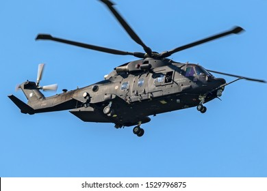 GILZE-RIJEN, NETHERLANDS - MAY 30, 2018: Armed Italian Air Force HH-101A military combat search and rescue (CSAR) helicopter in flight over Gilze-Rijen airbase.