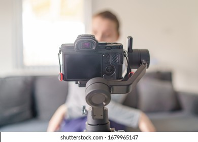 Gimbal with mirrorless camera blogger making video at home selective focus in day video blog