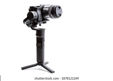 Gimbal three-axis motorized stabilizer with mounted mirrorless camera isolated on white background
