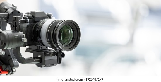 Gimbal video camera, Videographer using dslr camera anti shake tool for stabilizer record video.