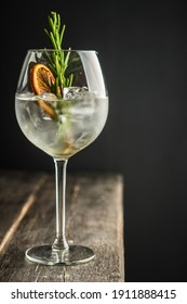 Gin based cocktail with triple sec in wine glass on the rustic background. Selective focus. Shallow depth of field.