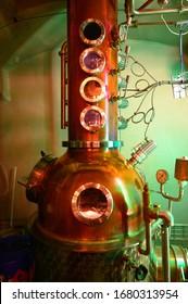 Gin distillation process in copper tanks, Scotland, UK