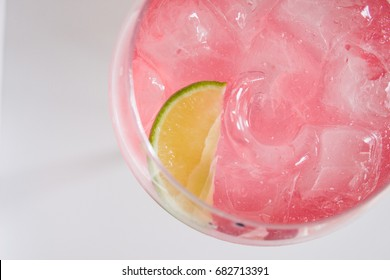Gin and pink tonic with lime