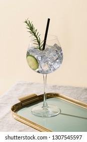 Gin tonic, an aperitif garnished with cucumber and rosemary