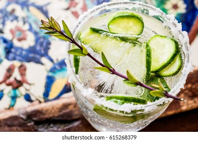 Gin Tonic Cocktail with cucumber slices and ice.