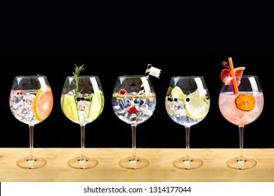 gin tonic cocktails fish bowl glass fruit garnish
