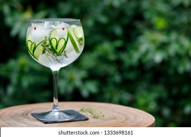 Gin and tonic with cucumber hearts and thyme