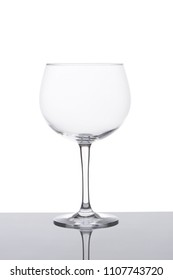 Gin and tonic glass isolated on white background