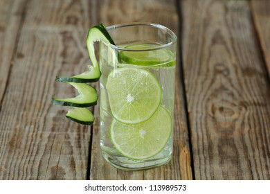 Gin tonic in a glass with lime and cucumber