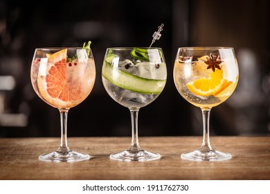 Gin tonic long drink as a classic cocktail in various forms with garnish in individual glasses such as orange, grapefruit, or cucumber.