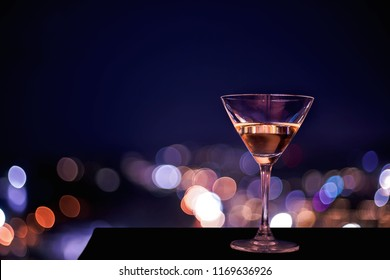 Gin and Tonic or margarita cocktail, night light over city background, Christmas festive celebration. End of the year, Welcome to New Year 2019. Good long holiday vacation with new thing when start up