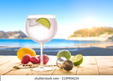 gin tonic on the beach
