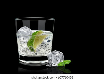 Gin tonic or vodka lime and basil isolated on black background