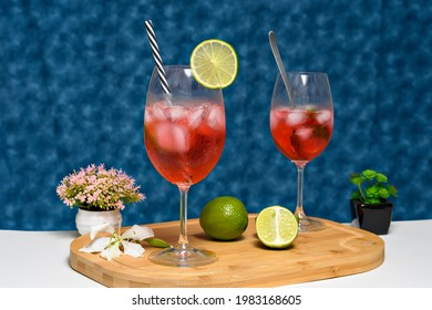 gin tonica drink with strawberry tea decorated with lemon