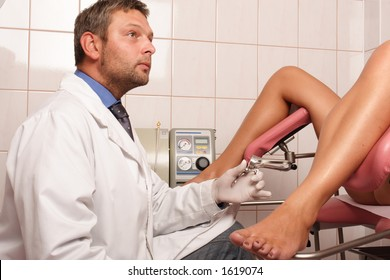 Ginecologist performing patient's examination