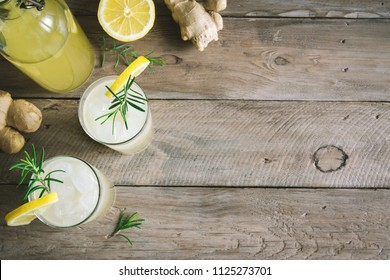 Ginger Ale or Kombucha in Glasses - Homemade lemon and ginger organic probiotic drink, copy space.