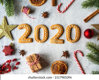 Ginger biscuits of the form of numbers and 2020 new year ginger cookies on grey background. Top view. Seasonal packaging and New Year's attributes