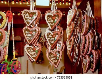Ginger bread Christmas decorations hanging with ribbon in St Enoch Christmas market in Glasgow. Scotland UK. November 2017
