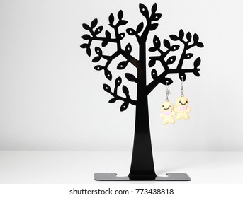 ginger bread erring hang on black tree figure