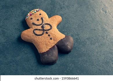 ginger bread man on a dark slate background