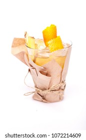 ginger cocktail with orange decorated with hank on white background